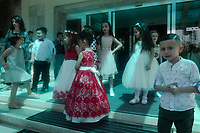 Albania. Tirana.  A groups of well-dressed boys and girls attending a birthday party stand on the stairs to the main entrance of Tirana International Hotel. The hotel is located on Skanderbeg Square and Zogu I Boulevard. Originally built in 1979 in a Soviet-era architectural style, the hotel was named Hotel Tirana. In 2001, it was fully renovated by an Italian company and is now a 4-star hotel. The Skanderbeg Square is the main plaza in the centre of Tirana and is named after the Albanian national hero Gjergj Kastrioti Skënderbeu ( 6 May 1405 – 17 January 1468), known as Skanderbeg or Skënderbeu who led a rebellion against the Ottoman Empire in what is today Albania.  20.5.2018 © 2018 Didier Ruef