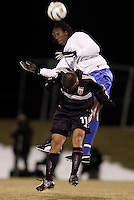 DC United's Alecko Eskandarian goes up for a header with Harbour View FC's Damion Stewart. D.C. United defeated Harbour View F. C. 2 to 1 in quarterfinals action of The CONCACAF Champions Cup at Maryland SoccerPlex, Boyds, MD, on March 9, 2005.