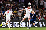 Alireza Jahan Bakhsh Jirandeh of Iran (C) fights for the ball with Endo Wataru of Japan (R) during the AFC Asian Cup UAE 2019 Semi Finals match between I.R. Iran (IRN) and Japan (JPN) at Hazza Bin Zayed Stadium  on 28 January 2019 in Al Alin, United Arab Emirates. Photo by Marcio Rodrigo Machado / Power Sport Images