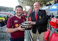 Monday 22nd April 2019 | 2019 Towns Cup Final<br /> <br /> Enniskillen captain Ryan Cathcart receives the Ulster Towns Cup from Ulster Branch President Stephen Elliott after the Ulster Towns Cup final between Enniskillen and Ballyclare at Kingspan Stadium, Ravenhill Park, Belfast. Northern Ireland. Photo John Dickson/Dicksondigital