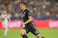 CARSON, CA - SEPTEMBER 15: Graham Smith #16 of Sporting Kansas City gets after a ball during a game between Sporting Kansas City and Los Angeles Galaxy at Dignity Health Sports Complex on September 15, 2019 in Carson, California.