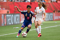 June 23, 2015: Saori ARIYOSHI of Japan and Lieke MARTENS of Netherlands fight for the ball during a round of 16 match between Japan and Netherlands at the FIFA Women's World Cup Canada 2015 at BC Place Stadium on 23 June 2015 in Vancouver, Canada. Japan won 2-1. Sydney Low/AsteriskImages.com