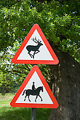 Richmond Park. Deer running and horse and rider red  triangle road signs.