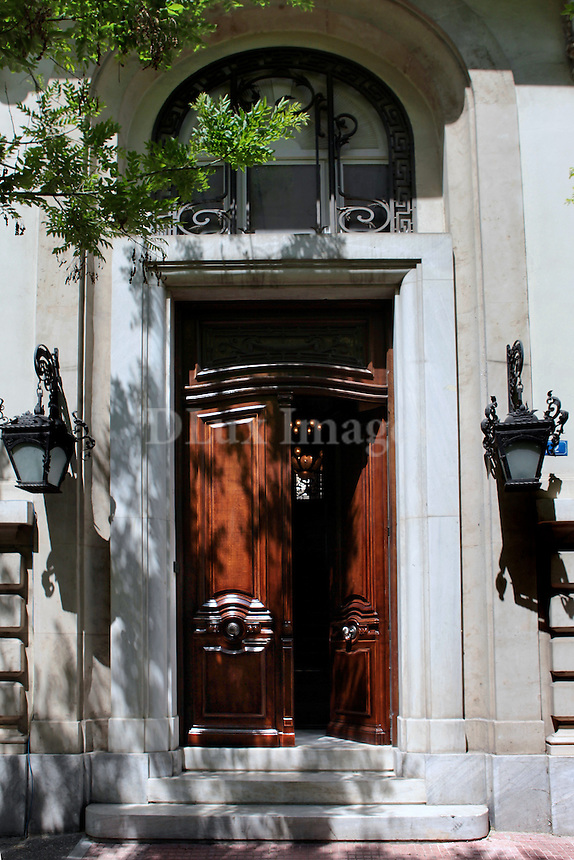 Mr. and Mrs. Routzouni live in this three storey, 1240 sq. m house with a large garden in the center of Athens.