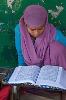 Female Madrasa Student Reading the Koran, Madrasa Islamia Arabia Izharul-Uloom, Dehradun, India.