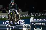 Marco Kutscher of Germany rides Cornet's Cristallo in action at the Longines Grand Prix during the Longines Hong Kong Masters 2015 at the AsiaWorld Expo on 15 February 2015 in Hong Kong, China. Photo by Aitor Alcalde / Power Sport Images