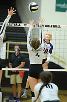 Fayetteville's Brooke Rockwell (20) sends the ball over the net Tuesday, Sept. 15, 2020, as Bentonville's Maddy Hughes (4) defends during play in Tiger Arena in Bentonville. Visit nwaonline.com/200916Daily/ for today's photo gallery. <br /> (NWA Democrat-Gazette/Andy Shupe)