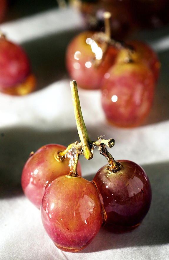Norwalk_112002_Grapes are candied in melted sugar for a dessert plate. Kerry Sherck/Staff photo