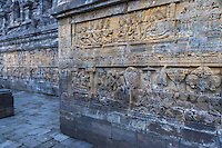 Borobudur, Java, Indonesia.  Bas-relief Carvings Depicting Scenes from the Life of the Buddha.