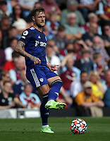 29th August 2021; Turf Moor, Burnley, Lancashire, England; Premier League football, Burnley versus Leeds United: Liam Cooper of Leeds United passes the ball to a team mate