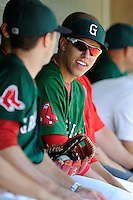 Center fielder Bryan Hudson (18) of the Greenville Drive talks with teammates during a game against the Charleston RiverDogs on Sunday, June 28, 2015, at Fluor Field at the West End in Greenville, South Carolina. Charleston won, 12-9. (Tom Priddy/Four Seam Images)