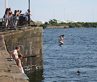 Saturday July 26th 2014 <br /> Pictured: Cardiff Bay <br /> RE: Young girl jumps into the water at Cardiff Bay during the heat wave