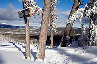 """A trail sign indicates the top of """"Glory Hole"""" a black diamond run at Showdown Ski Area on King's Hill in the Little Belt Mountains near Neihart, Montana, USA."""