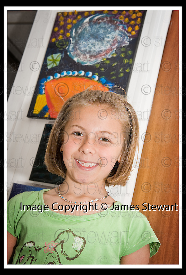 22/06/2009  Copyright  Pic : James Stewart.26_cross_currents.DELTA STUDIOS :: CROSS CURRENTS EXHIBITION :: EVA SMITH (8), FROM ST ANDREW'S PRIMARY, WITH ONE OF HER PAINTINGS :: .James Stewart Photography 19 Carronlea Drive, Falkirk. FK2 8DN      Vat Reg No. 607 6932 25.Telephone      : +44 (0)1324 570291 .Mobile              : +44 (0)7721 416997.E-mail  :  jim@jspa.co.uk.If you require further information then contact Jim Stewart on any of the numbers above.........