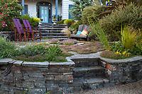Custom built quartz rock walls for patio with chairs, Shelagh Tucker garden, Seattle, Washington