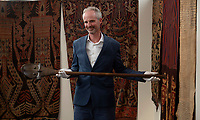 BNPS.co.uk (01202) 558833.<br /> Pic: BNPS<br /> <br /> PICTURED: African & Oceanic Art expert, Will Hobbs with the marquee lot that is an exquisite 19th century Polynesian 4.5ft-long war club valued at £30,000.<br /> <br /> A remarkable assortment of African and Oceanic artefacts are being sold at a British auction house.<br /> <br /> The rare relics, which have come from several prominent private collections, include tribal weapons, figures and masks.<br /> <br /> They are going under the hammer with auctioneers Woolley & Wallis, of Salisbury, Wilts.<br /> <br /> The marquee lot is an exquisite 19th century Polynesian 4.5ft-long war club valued at £30,000.<br /> <br /> Also up for grabs is an eye-catching 25ins Chokwe bird head mask originating from Angola with a modest estimate of £800. A wooden 30ins standing male figure from the Bay of Bengal, India, which was carved to ward off evil spirits could fetch £3,000.