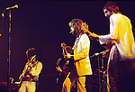 Eric Clapton 1973 at the Rainbow Concert with Ron Wood and Pete Townshend<br /> © Chris Walter