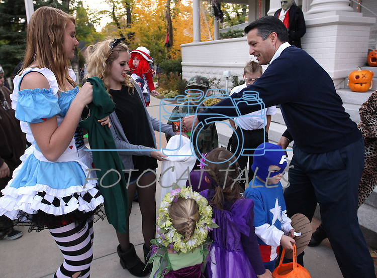 Gov. Brian Sandoval hands out candy at the Governor's Mansion in Carson City, Nev. on Wednesday, Oct. 31, 2012. In addition to donations by other local businesses, Kimmie Candy donated 3,000 bags of candy to be handed out to the thousands of trick-or-treaters. .Photo by Cathleen Allison