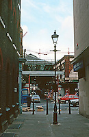 """London:  Spitalfields Market from Puma Court, where Dickens walked. Is the sign """"Takhar Brothers"""" visible?  Photo '90."""