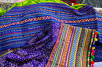 India, Gujarat, Bhadroi, Kutch Desert. Textiles used in Pabiben's bag business.
