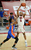 Arkansas guard Moses Moody (5) pulls down a rebound Tuesday, Feb. 16, 2021, as Florida guard Noah Locke (left) defends during the first half of play in Bud Walton Arena. Visit nwaonline.com/210217Daily/ for today's photo gallery. <br /> (NWA Democrat-Gazette/Andy Shupe)
