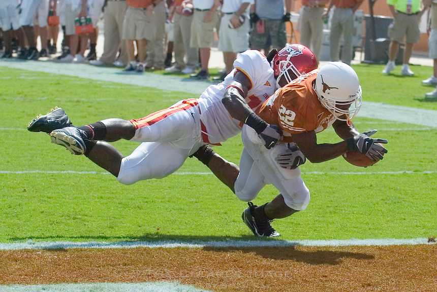 23 September 2006: Texas back Selvin Young (#22) dives past Iowa State defender Alvin Bowen (#15) during the Longhorns game against the Iowa State Cyclones at Darrell K Royal Memorial Stadium in Austin, TX.