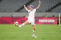 TOKYO, JAPAN - JULY 20: Megan Rapinoe #15 of the United States traps the ball during a game between Sweden and USWNT at Tokyo Stadium on July 20, 2021 in Tokyo, Japan.