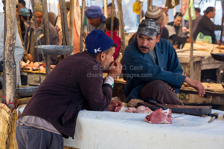 Morocco.  Men Talking, Had Draa Market, Essaouira Province.
