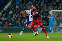 WEST BROMWICH, ENGLAND - FEBRUARY 11:   Ashley Williams of Swansea City  moves the ball forwards during the Premier League match between West Bromwich Albion and Swansea City at The Hawthorns on February 11, 2015 in West Bromwich, England. (Photo by Athena Pictures/Getty Images)