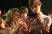 """Edmund"" becomes bewitched by a gift of Turkish Delight from the ""Wicked Queen"".  The Yvonne Arnaud Youth Theatre rehearsing ""The Lion, the Witch and the Wardrobe"", Guildford, Surrey."