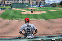 """Former Red Sox pitcher Daniel Bard contemplates his performance in a """"Sandlot""""-style game concluding a series of workouts with local MLB and MiLB players from around the Upstate region on Thursday June 25, 2020, at Fluor Field at the West End in Greenville, South Carolina. Bard played for the Greenville Drive in 2007-2008, then Boston for five years and is now attempting a comeback with the Rockies. (Tom Priddy/Four Seam Images)"""