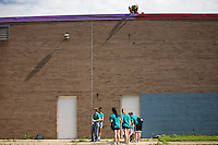 """Samantha Zent, top, paints on the roof during """"Circle the City with Service,"""" the Kiwanis Circle K International's 2015 Large Scale Service Project, on Wednesday, June 24, 2015, at the Friendship Westside Center for Excellence in Indianapolis. (Photo by James Brosher)"""