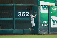 Vanderbilt Commodores left fielder Walker Grisanti (17) makes a leaping catch in front of the 362' sign during the game against the Louisiana Ragin' Cajuns in game five of the 2018 Shriners Hospitals for Children College Classic at Minute Maid Park on March 3, 2018 in Houston, Texas.  The Rajin' Cajuns defeated the Commodores 3-0.  (Brian Westerholt/Four Seam Images)