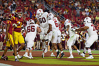 LOS ANGELES, CA - SEPTEMBER 11: Branson Bragg #66, Drake Nugent #60, Elijah Higgins #6, Austin Jones #20 and Walter Rouse #75 of the Stanford Cardinal celebrate after a touchdown during a game between University of Southern California and Stanford Football at Los Angeles Memorial Coliseum on September 11, 2021 in Los Angeles, California.