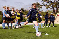USWNT captain Christie Rampone strikes the ball during a team competition at practice for the Algarve Cup in Albufeira, Portugal.