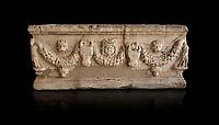 Roman relief garland sculpted sarcophagus.  Adana Archaeology Museum, Turkey. Against a black background