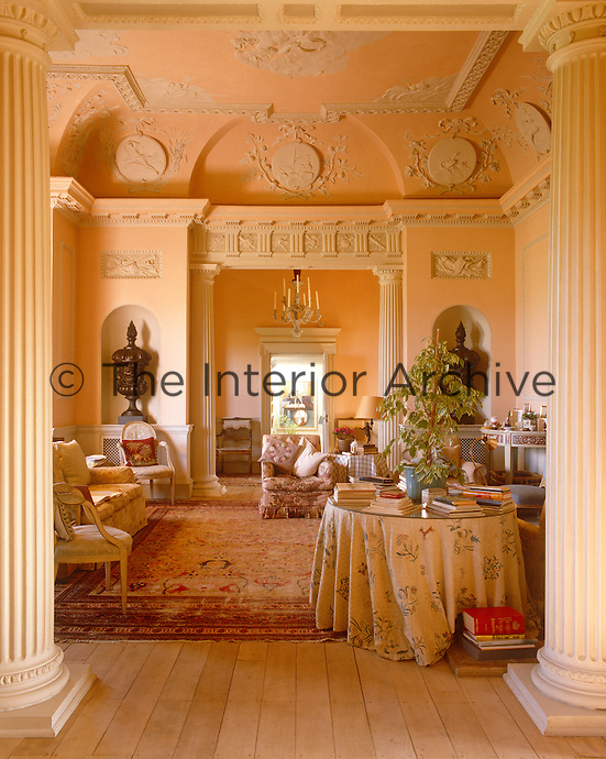 The saloon in the Menagerie at Horton with its restored rococo plasterwork. The urns are copied from the limewood models Rex Whistler made for Samuel Cortauld