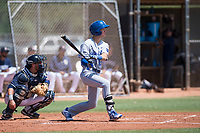 AZL Royals designated hitter Gage Hughes (12) follows through on his swing in front of catcher Rainier Aguilar (8) during an Arizona League game against the AZL Padres 1 at Peoria Sports Complex on July 4, 2018 in Peoria, Arizona. The AZL Royals defeated the AZL Padres 1 5-4. (Zachary Lucy/Four Seam Images)