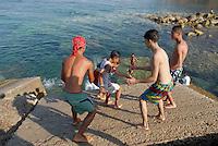 - bathing young people on waterfront of Tabarka town....- giovani bagnanti sul lungomare della città di Tabarka
