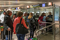 Traveler security check at Barcelona airport, Spain.