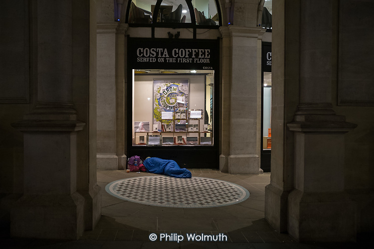 Rough sleeper outside Costa Coffee, Trafalgar Square, London.