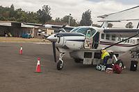 Tanzania. Unloading Luggage at Arusha Domestic Airport.