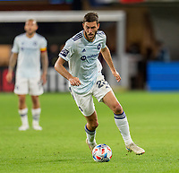 WASHINGTON, DC - MAY 13: Elliot Collier #28 of Chicago Fire FC dribbles the ball during a game between Chicago Fire FC and D.C. United at Audi FIeld on May 13, 2021 in Washington, DC.