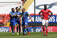 Wigan's Kal Naismith (No 33) congratulates Jamal Lowe (far left) after scoring Wigan's opening goal during Charlton Athletic vs Wigan Athletic, Sky Bet EFL Championship Football at The Valley on 18th July 2020