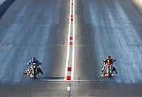 Feb 24, 2017; Chandler, AZ, USA; NHRA top fuel nitro Harley Davidson rider Jay Turner (left) races alongside Rickey House during qualifying for the Arizona Nationals at Wild Horse Pass Motorsports Park. Mandatory Credit: Mark J. Rebilas-USA TODAY Sports