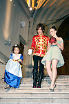 """July 18, 2012, Tokyo, Japan - (L-R) The child actress Tani Kanon, the actor Daigo and Lily Collins leave the St. Grace Cathedral at the Premier of """"Mirror Mirror"""" in Tokyo. The """"Mirror Mirror"""" film tells the story of an orphaned princess called Snow White (Lilly Collins) and her cruel stepmother the Queen (Julia Roberts) who plans to take over the kingdom. The Queen tries to get rid of Snow White by throwing the forest, but princess is rescued by a band of diminutive highway robbers, and with them she seeks to recover her kingdom. This film will be released from September 14 in Japan. (Photo by Rodrigo Reyes Marin/AFLO)"""