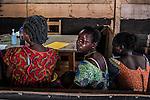CAR,Bangui:  A woman is sitting and waiting to be examined by a doctor at the MSF clinic of Mpoko. 21th April 2016.<br /> <br /> RCA, Bangui: une femme est assise et attend de pouvoir se faire examiner par un docteur à la clinique MSF du camp Mpoko. 21 avril 2016