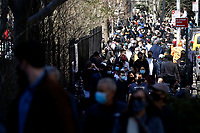 NEW YORK - NEW YORK - MARCH 21: People walk around a rally against Asian hate at Columbus Park in Chinatown on March 21, 2021 in New York. In the last two months, more than 500 attacks on Asians have been reported in United States. (Photo by John Smith/VIEWpress)