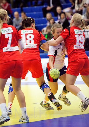 31 MAR 2010 - LONDON, GBR - Britains Nina Heglund (in white) tries to find a way through the Icelandic defence in the two teams 2010 European Womens Handball Championships qualifier .(PHOTO (C) NIGEL FARROW)