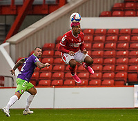 3rd October 2020; City Ground, Nottinghamshire, Midlands, England; English Football League Championship Football, Nottingham Forest versus Bristol City; Lyle Taylor of Nottingham Forest heads the ball on